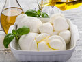 Olive oil over mozzarella Stock Photos