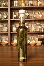Olive oil with peppercorns bottle and aromatic herbs Royalty Free Stock Image