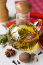 Olive oil with rosemary and chilli Stock Photography