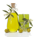 Olive oil and soap with a sprig of blossoms olives on white background Royalty Free Stock Photo