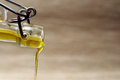 Olive oil stream extra virgin pouring from bottle closeup Royalty Free Stock Photography
