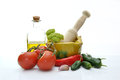 Olive oil with tomatoes garlic and other ingredients Stock Photo