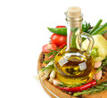 Olive oil vegetables and spices on a white background Royalty Free Stock Photo