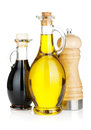 Olive oil and vinegar bottles with pepper shaker Royalty Free Stock Photo