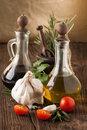 Olive oil and vinegar, gralic, tomatoes with herbs Royalty Free Stock Photo