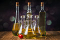 Olive oils in bottles with ingriedients composition of Royalty Free Stock Images