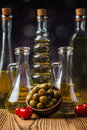 Olive oils in bottles with ingriedients composition of Royalty Free Stock Photos