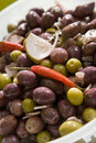 Olives in bowl calamata and green with chilli lemon and garlic Royalty Free Stock Images