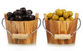 Olives in buckets green and black wooden Stock Photo