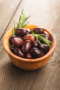 Olives calamata wooden bowl table Royalty Free Stock Image