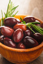 Olives calamata wooden bowl table Stock Photography