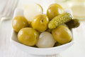 Olives and cucumbers in bowl Stock Photography