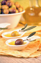 Olives with extra virgin olive oil Stock Images