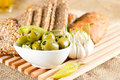 Olives and garlic with tasty bread Royalty Free Stock Photo