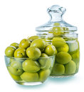 Olives in a glass preserved vegetables composition large green marinade few shots are combined to increase the area of focus Stock Photo