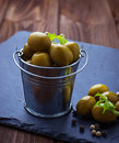 Olives in iron bucket Royalty Free Stock Photo