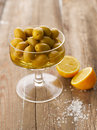 Olives and lemons bowl of with lemon salt on wooden table shallow focus vibrant color Stock Photo