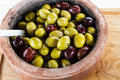 Olives lovely juicy fat from the mediterranean in rustic bowl Royalty Free Stock Photography