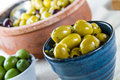 Olives lovely juicy fat from the mediterranean in rustic bowl Royalty Free Stock Image