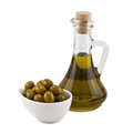 Olives and olive oil in a bottle Royalty Free Stock Photo