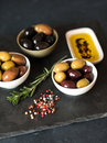 Olives and olive oil on dark stone Royalty Free Stock Photo