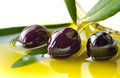 Olives olive oil and fresh black closeup concept of healthy mediterranean diet food background Royalty Free Stock Photo