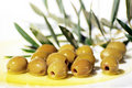 Olives and Olive Oil on plate Royalty Free Stock Photo
