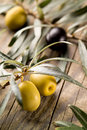 Olives over wooden background soft focus Royalty Free Stock Images