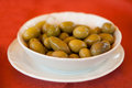 Olives pebble of the greens of on red table cloth Stock Photography
