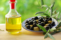 Olives on plate and oliveoil Royalty Free Stock Photo
