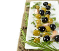 Olives with rosemary on a white plate Stock Photo