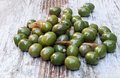 Olives surrounded by rustic background Royalty Free Stock Images