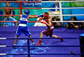Olympic boxer lands jab punch Royalty Free Stock Photo