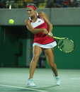 Olympic champion Monica Puig of Puerto Rico in action during tennis women's singles final of the Rio 2016 Olympic Games Royalty Free Stock Photo