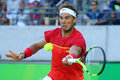 Olympic champion Rafael Nadal of Spain in action during men`s singles semifinal of the Rio 2016 Olympic Games Royalty Free Stock Photo