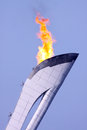 Olympic fire over bkue sky sochi russia february at sochi xxii winter games Royalty Free Stock Photos