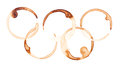 Olympic rings made from coffee stains isolated on white background Royalty Free Stock Photos