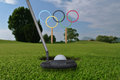 Olympic rings stand under bright blue sky iin a golf course Royalty Free Stock Photo