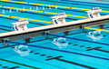 Olympic sport competition swimming pool lanes beautiful in a clear transparent blue water facility Stock Photography