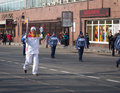 The olympic torch relay vladivostok russia november torchbearer carries flame in of flame on november in vladivostok russia Stock Photography