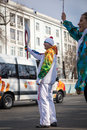 The olympic torch relay vladivostok russia november torchbearer carries flame in of flame on november in vladivostok russia Stock Image
