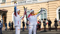 The olympic torch relay vladivostok russia november torchbearer carries flame in of flame on november in vladivostok russia Stock Photo