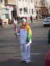 The olympic torch relay vladivostok russia november torchbearer carries flame in of flame on november in vladivostok russia Stock Photos
