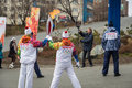 The olympic torch relay vladivostok russia november torchbearer carries flame in of flame on november in vladivostok russia Stock Images