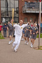 Olympic Torchbearer Paul Giblin with the torch Royalty Free Stock Photo