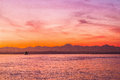 An olympic washington sunset over a ferry vibrant colorful the mountains across the puget sound from seattle with and beautiful Royalty Free Stock Photo