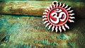 Om pendent on wood background and greeting