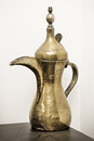Omani coffee pot a traditional brass on a shelf Royalty Free Stock Photography