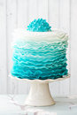 Ombre ruffle cake in shades of blue Royalty Free Stock Photos