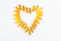 Omega 3 pills in shape of heart Royalty Free Stock Photo